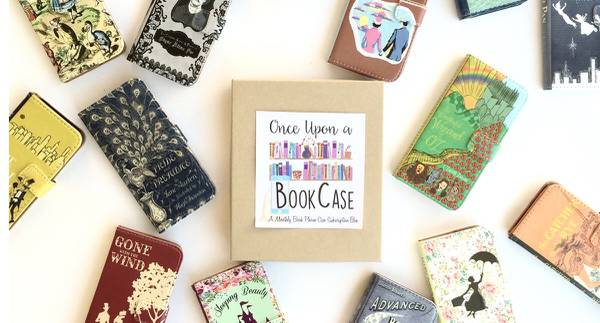 Once Upon a BookCase box surrounded by many wallets with book covers printed on them.